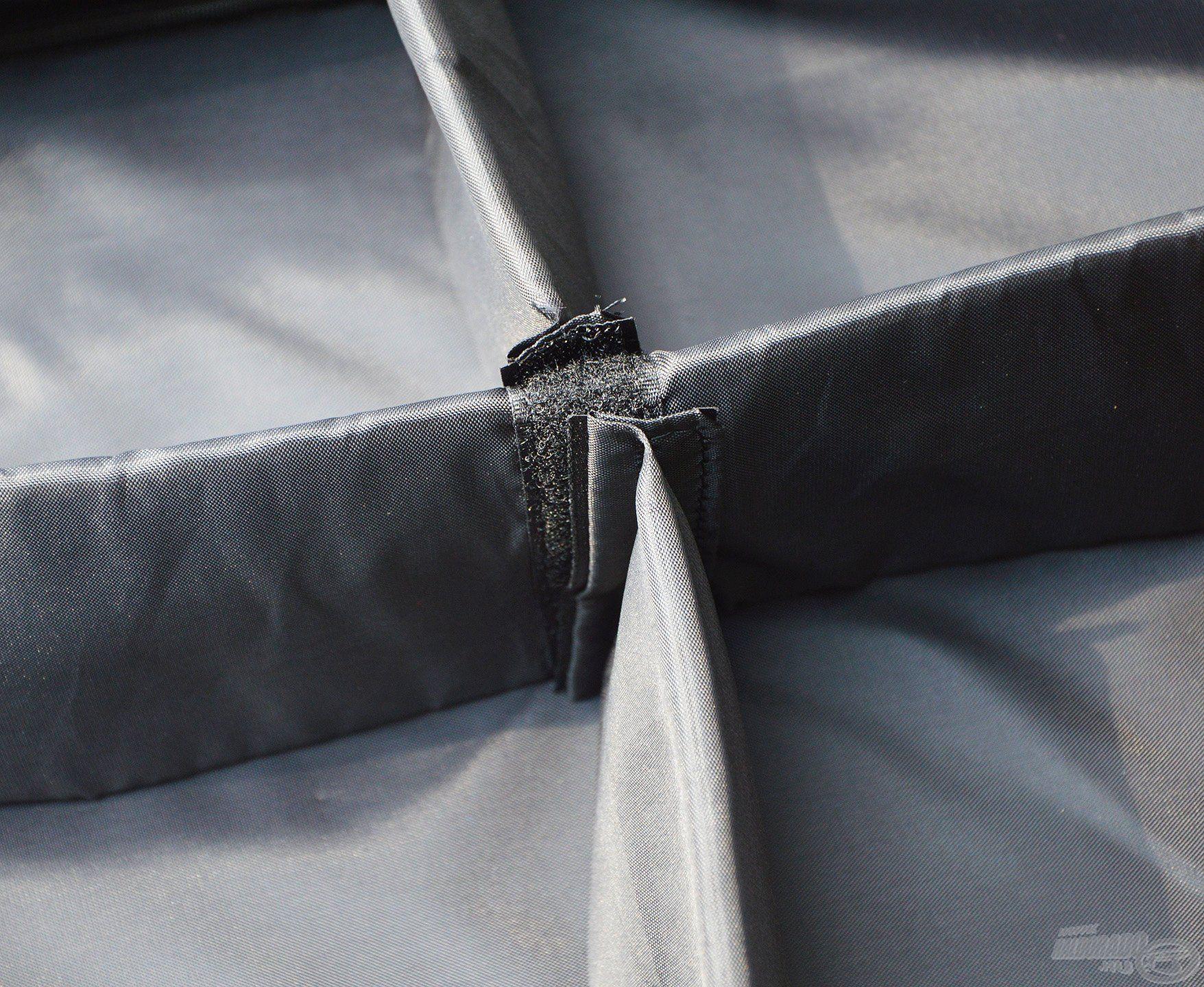 Kivehető, tépőzárral rögzíthető elválasztókkal lehet négyfelé osztani a belső teret