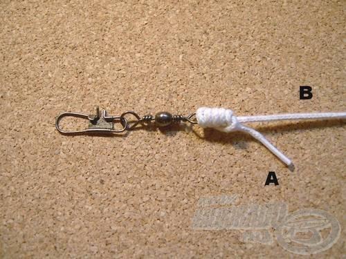 Rendezzük a kötés meneteit és nedvesítés után húzzuk szorosra. A felesleges (A) véget vágjuk vissza
